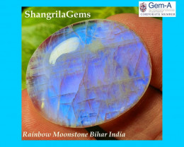 32mm 43ct rainbow moonstone 32 by 26 by 5mm slight chip on side