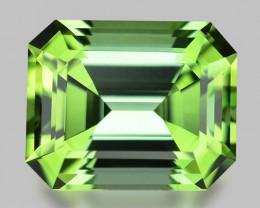 Exquisite, precision custom cut neon green Namibian tourmaline.