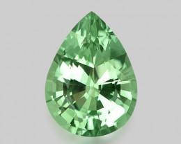 Flawless, custom precision pear cut natural neon green tourmaline.