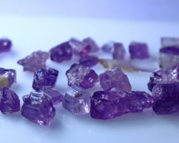 60.10 CTs CT Natural & Unheated Purple Scapolite Rough Lot