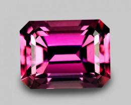 Precision custom emerald cut natural purplish pink sapphire.