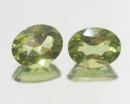 4.2 Ct Peridot Matching Pair Faceted Oval Cut 9x7mm.- Olivine Green.(SKU 42