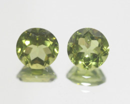 4.15 Ct Peridot Matching Pair Faceted Round Cut 7.7mm.- Olivine Green.(SKU