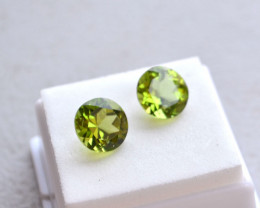 8.27 Carat Matched Pair of Fine Peridot Rounds