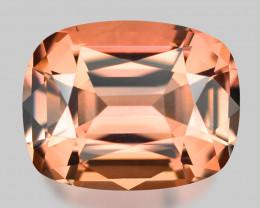 Precision custom cushion cut pinkish peach Madagascan tourmaline.