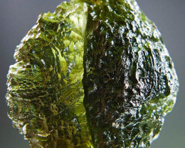 Rare Moldavite with natural etched break CERTIFIED