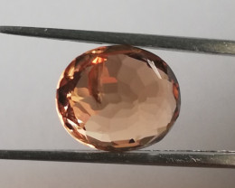 Tourmaline, 2.5ct, very nice orange colour! A little crack on the back!