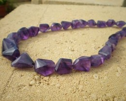 NATURAL AMETHYST TAPERED FACET CHUNKY BEAD STRAND 400 ct
