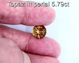 5.79cts Natural Imperial Topaz      Round Cut