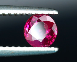 BURMESE RUBY with NEON RED .66CTs in A ROUND CUT