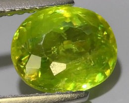 1.95 Cts-Excellent Hot Neon Green Sparks- Sphene/Titanite- Oval Gem!!