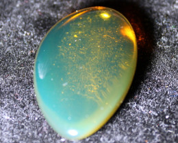 Dominican Natural Crystal Clear Cognac Blue Amber Polished Stone 33x21x8mm