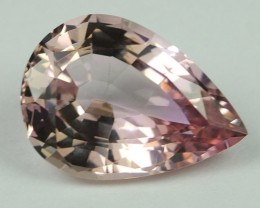 6.67 CTS TANZANITE -ZIOSITE  ORANGE-PINK CERTIFIED GRS