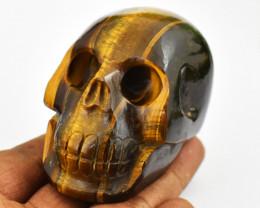 Genuine 787.00  Cts Tiger Eye Hand Carved Skull Carving