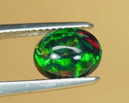 1.47CT NATURAL BLACK OPAL with GREEN & RED PINFIRE $1NR!