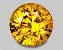 Flawless, precision custom round cut natural yellow sapphire.