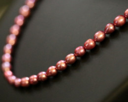 105 cts Hot Pink / Mauve Oval luster Pearl strand. GOGO 1301