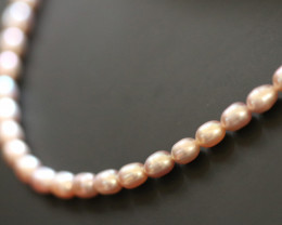 68 cts Oval Natural Pink luster Pearl strand. GOGO 1307
