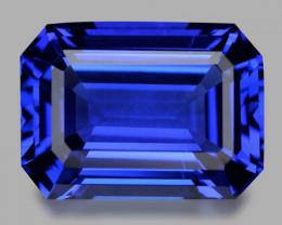 Flawless, custom precision emerald cut vivid blue tanzanite.