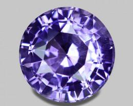 Exquisite custom round brilliant cut natural purple sapphire.