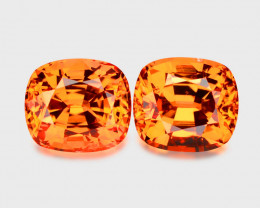 Flawless, high gem custom precision cut pair mandarine garnets.