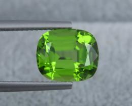 IF 5.80 Natural Green Color Step Cushion Cut Peridot From Pakistan