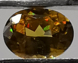 Sphene, 0.73ct, spectacular colour range, awesome gem!!