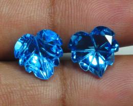 9.230 CRT LOVELY PAIR SWISS BLUE TOPAZ CARVING-