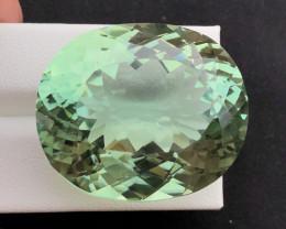 139.55 carats greenish spodumene gemstone