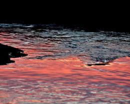 Sunset reflections.   Big Island, Hawaii.