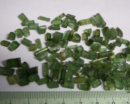 138 carats transluscent untreated  facet grade rough green tourmaline lot *