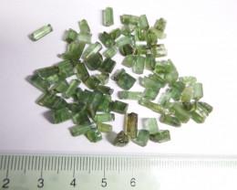 100.85 carats transluscent untreated facet grade rough green tourmaline lot
