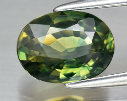 CERTIFICATE Inc.*1.39ct VVS Oval Natural Unheated Yellowish Green Sapphire