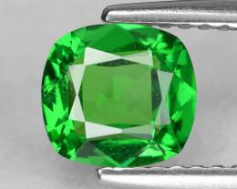 Exquisite precision cushion-cut vivid green tsavorite garnet.