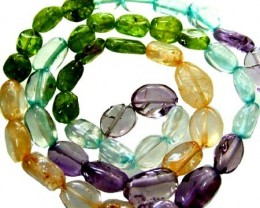 FOUR DIFERENT  COLOURFUL STONES  IN STRAND 66.60 CTS GT 1591