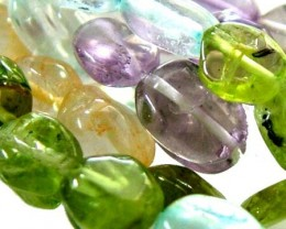 FOUR DIFERENT  COLOURFUL STONES  IN STRAND 67.65 CTS GT 1594