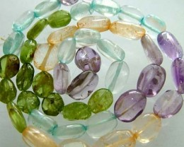 FOUR DIFERENT  COLOURFUL STONES  IN STRAND 67.90 CTS GT 1598