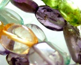 FOUR DIFERENT  COLOURFUL STONES  IN STRAND 69.50 CTS GT 1601