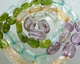 FOUR DIFERENT  COLOURFUL STONES  IN STRAND 68.85 CTS GT 1604