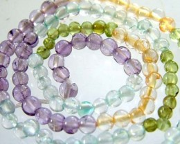 FOUR DIFERENT  COLOURFUL STONES  IN STRAND 25.60 CTS GT 1612