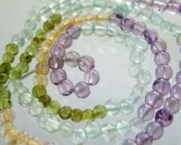 FOUR DIFERENT  COLOURFUL STONES  IN STRAND 25.70 CTS GT 1615