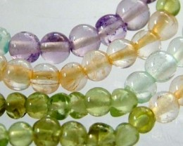 FOUR DIFERENT  COLOURFUL STONES  IN STRAND 25.30 CTS GT 1619