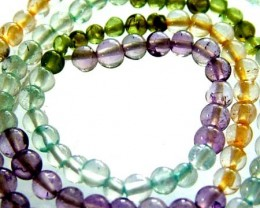 FOUR DIFERENT  COLOURFUL STONES  IN STRAND 24.50 CTS GT 1625
