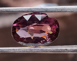 Spinel, 0.85ct, a broken personality in an auction for a dollar.