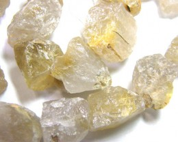 NATURAL RUTILATED QUARTZ  ROUGH DRILLED  825CTS TBG-122