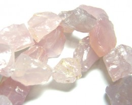 NATURAL ROSE QUARTZ  ROUGH DRILLED 643 CTS TBG-129