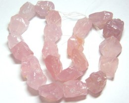 NATURAL ROSE QUARTZ  ROUGH DRILLED  690CTS TBG-132