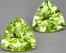 PAIRE OF 100%  NATURAL PERIDOTS..7mm Trillion.SUPERBE!