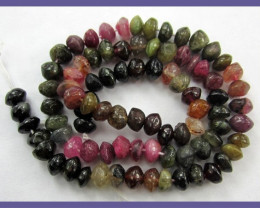 A GRADE 5-6MM MULTI-COLORED TOURMALINE SMOOTH BUTTON BEADS