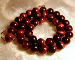 China Red Tiger Eye Strand - 304.5Ct., 10.3mm pcs. 15.5 in.